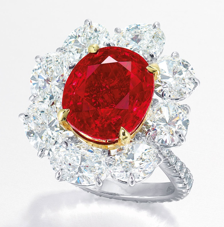 A superb ruby and diamond ring, by Faidee. The oval-shaped ruby, weighing approximately 10.05 carats, within a radiating surround of oval-shaped diamonds, to the circular-cut diamond gallery, extending to the undulating hoop, mounted in platinum and gold, ring size 6¼. Signed and with maker's mark for Faidee. Estimate HK$ 68,800,000-98,000,000  $8,800,000-12,500,000. This lot is