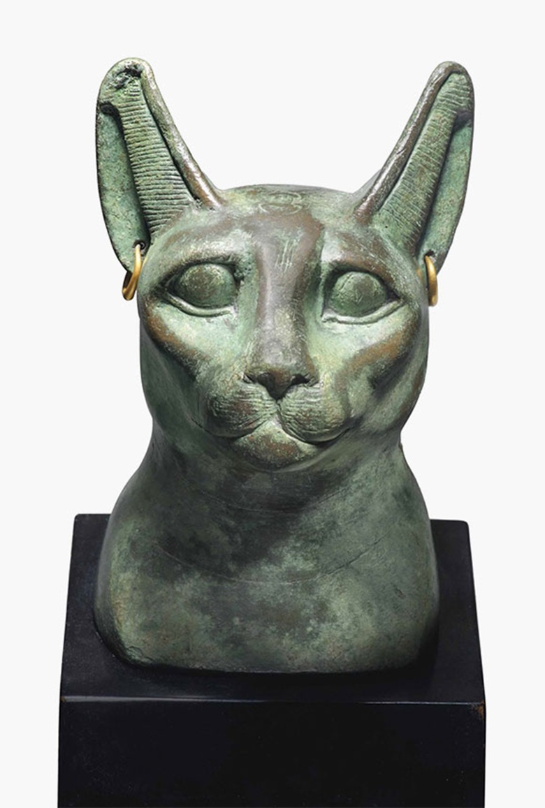 An Egyptian bronze cat head. Late Period-Ptolemaic Period, circa 664-30 B.C. 4¾ in (12 cm) high. This lot was offered in The Resandro Collection on 6 December 2016 at Christie's in London and sold for £106,250