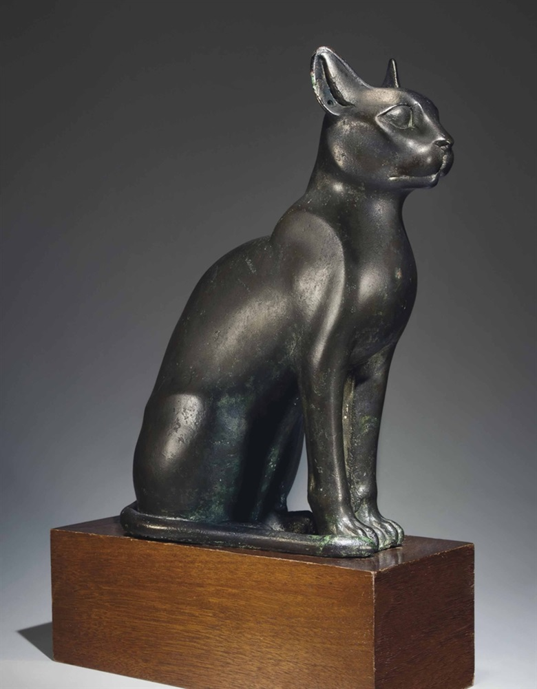 An Egyptian bronze cat. Ptolemaic Period, 304-30 B.C. 13⅝ in (34.6 cm) high. Sold for $2,027,750 on 6 June 2013