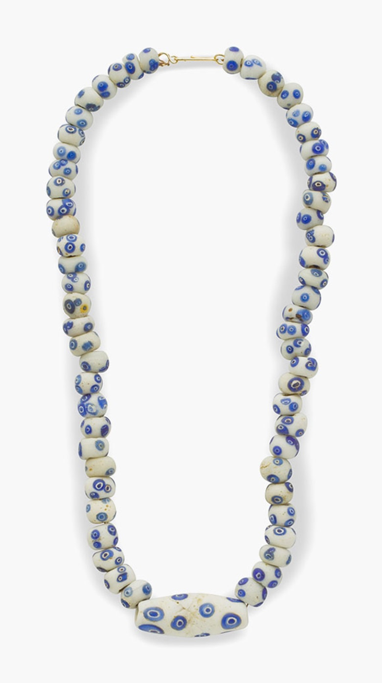 A Carthaginian white and blue glass eye-bead necklace. Circa 4th-2nd century B.C. 18¾ in (47 cm) long. Estimate $5,000-7,000. This lot is offered in Ancient Jewelry Wearable Art, 29 November–8 December 2016, Online