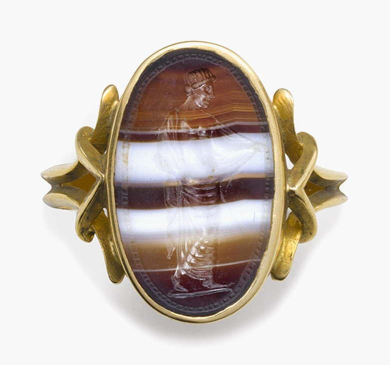 An italic banded agate ringstone with a partially draped goddess. Circa 2nd century B.C. ¾ in (1.9 cm) long; ring size 8½. Estimate $3,000-5,000. This lot is offered in Ancient Jewelry Wearable Art, 29 November–8 December 2016, Online