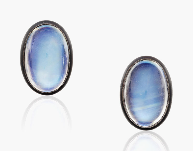Hemmerle iron, white gold and moonstone cufflinks, circa early 21st century. Each set with an oval cabochon moonstone within a bezel of blackened iron, to the white gold connector links. Estimate $1,500-2,500. This lot is offered in Cufflinks for the Modern Gentleman, 1-13 December, Online