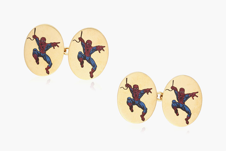 Marvel 'Spiderman' gold and enamel cufflinks, circa 2000s. Each designed as an oval gold plaque applied with an enamel Spiderman.  Estimate $800-1,200. This lot is offered in Cufflinks for the Modern Gentleman, 1-13 December, Online