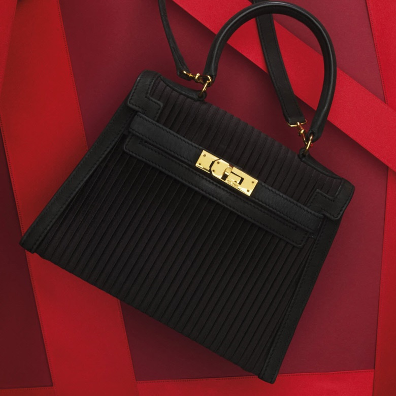 A black pleated silk & leather mini Kelly 20 bag. Estimate $6,000-8,000. This lot is offered in Handbags and Accessories, 1-12 December 2016, Online