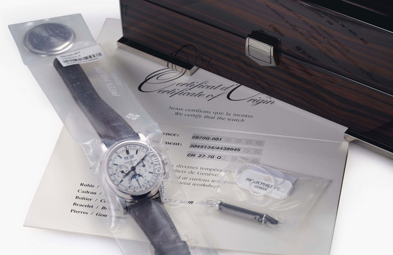 Patek Philippe. A rare 18k white gold perpetual calendar chronograph wristwatch with moon phases and additional solid caseback, factory sealed. Signed Patek Philippe, Genève, Ref. 5970G, Movement No. 3049134, Case No. 4438645, Circa 2008. This lot was offered in Rare Watches including NAUTILUS 40 part IV on 6 December 2016 at Christie's in New York and sold for $125,000