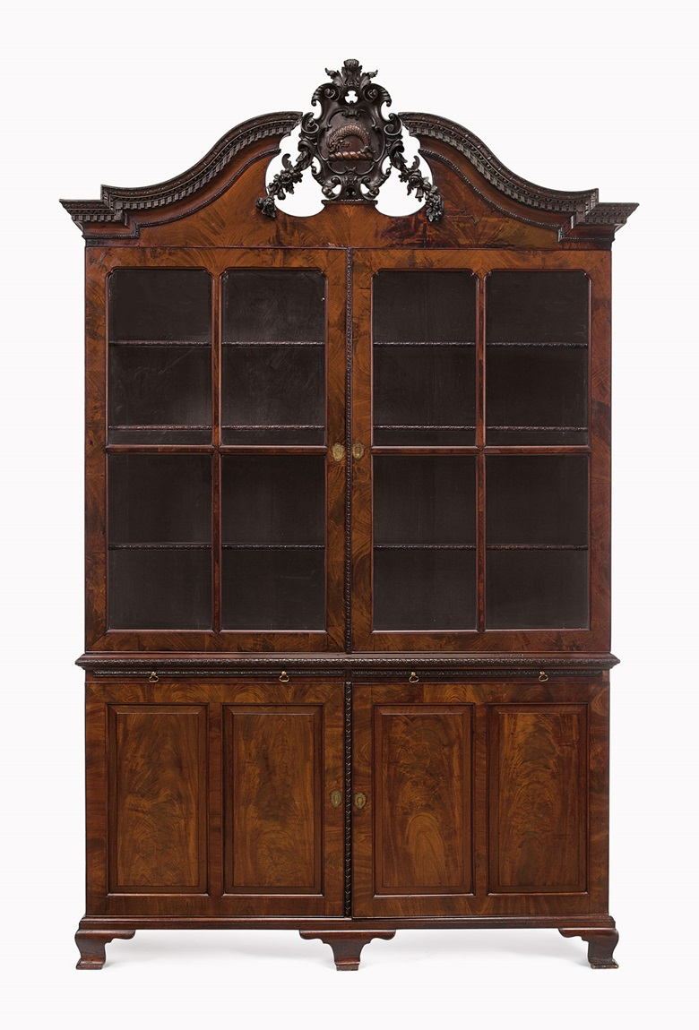 A George II mahogany bookcase cabinet. Circa 1750. 117½ in (298.5 cm) high, 74 in (188 cm) wide, 20¼ in (51.5 cm) deep. Estimate $60,000-100,000. This lot is offered in Palmetto Hall The Jay P. Altmayer Family Collection on 19 January 2017 at Christie's in New York