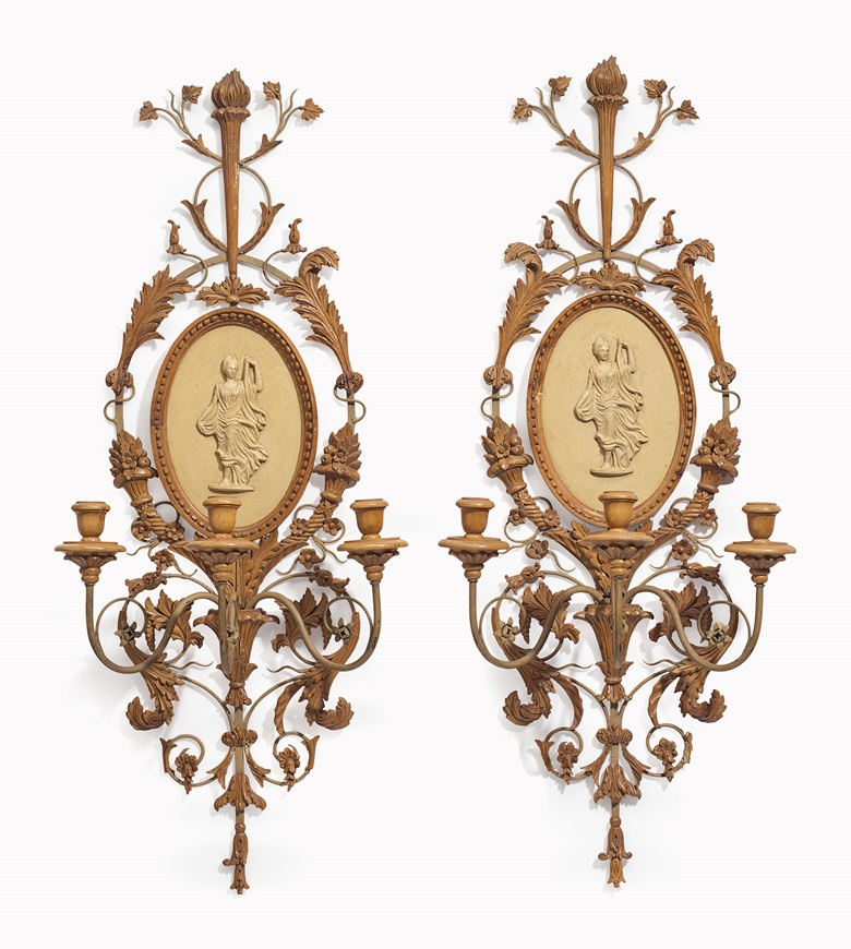 A pair of Italian stained pine, painted-metal and composition three-light wall sconces. 20th century. 36½ in (92 cm) high, 12½ in (32 cm) wide. Estimate $500-800. This lot is offered in Palmetto Hall The Jay P. Altmayer Family Collection on 19 January 2017 at Christie's in New York