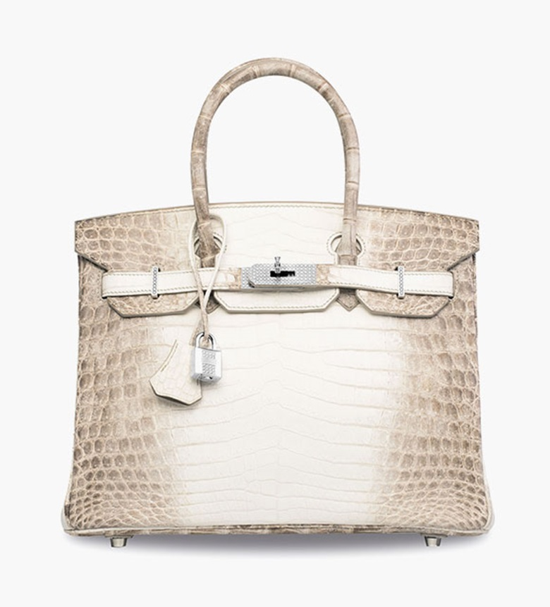 An exceptional, matte white Himalaya Niloticus Crocodile Diamond Birkin 30 with 18k white gold & diamond hardware. Hermès, 2008. Featuring 245 F-colour, VVS clarity diamonds for a total diamond carat weight of 9.84, set in 174.4g 18k white gold. This lot was offered in 30 Years The Sale on 30 May 2016 at Christie's in Hong Kong and sold for HK$631,560,000US$81,712,921