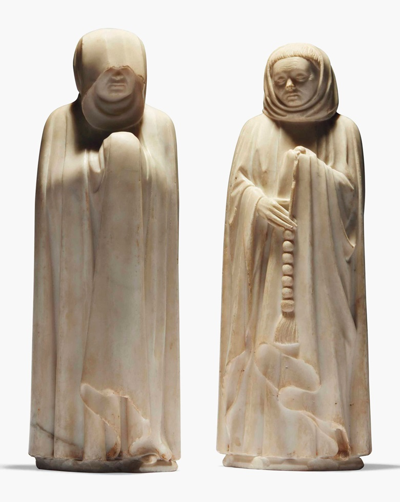 Two sculpted marble mourners from the tomb of Jean de France, Duc de Berry, by Jean de Cambrai, circa 1396-1416. Sold for €5,025,000 on 15 June at Christie's in Paris