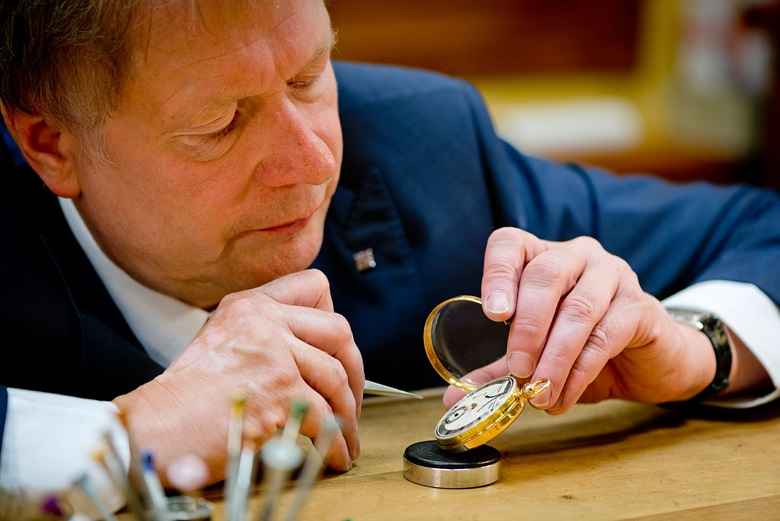 Dr. Friess inspects a watch made by Breguet, acquired from Christie's in 2016
