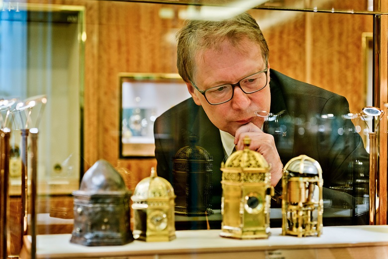 Dr. Friess inspects some of the many rare pieces on display from the Stern Collection