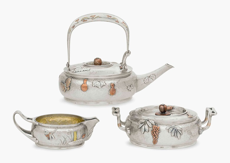 A silver, mokume and mixed-metal three-piece tea set. Mark of Tiffany & Co., New York, 1878, with French import marks. The teapot 7⅝ in (19.5 cm) long; 36 oz. 12 dwt. (1,140 gr). This lot was offered in Important American Furniture, Folk Art and Silver on 20 January 2017 at Christie's in New York and sold for $65,000