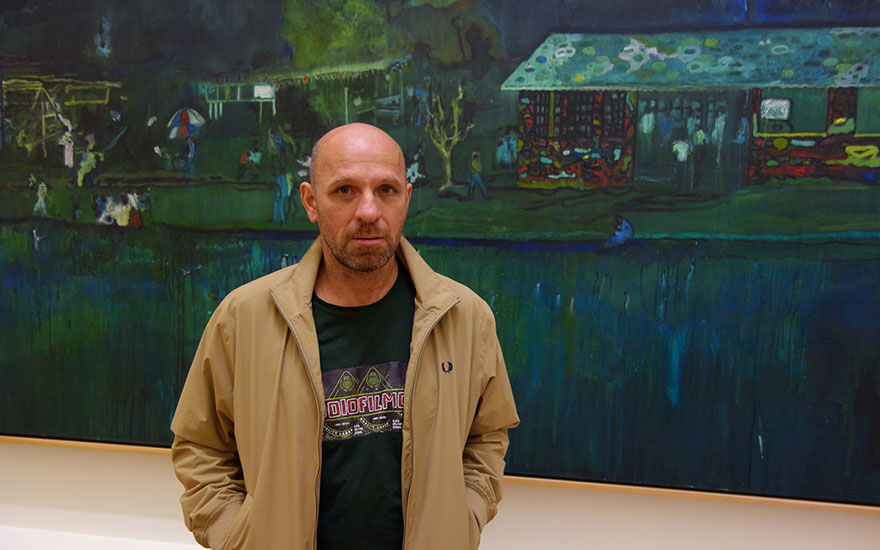 Peter Doig with his work Music of the Future (detail), 2002-2007. Artwork © Peter Doig. All Rights Reserved, DACS 2017      .full-screen .image-preview { background-position 50% 30%!important; }