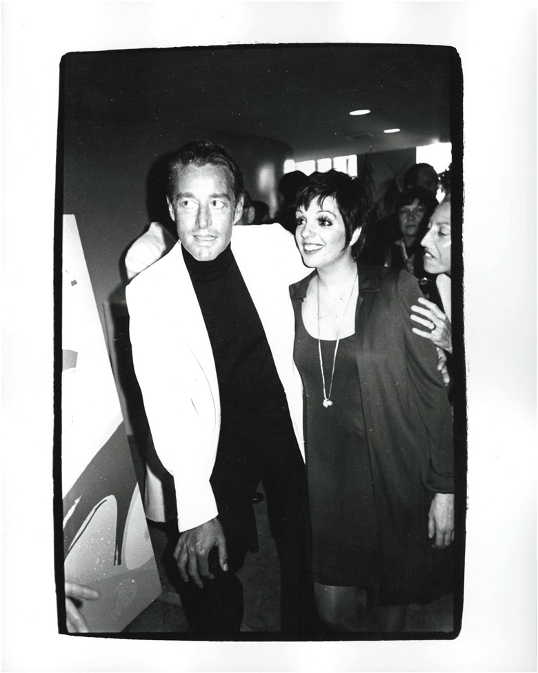 Andy Warhol (1928-1987), Halston And Liza Minnelli, 1982. Unique gelatin silver print, 10 x 8 in (25.4 x 20.3 cm). Estimate $4,000-6,000. This work is offered in Andy Warhol@Christie's with NYFW The Shows online auction, 8-16 February 2017 © The Andy Warhol Foundation for the Visual Arts, Inc.  Artists Rights Society (ARS), New York