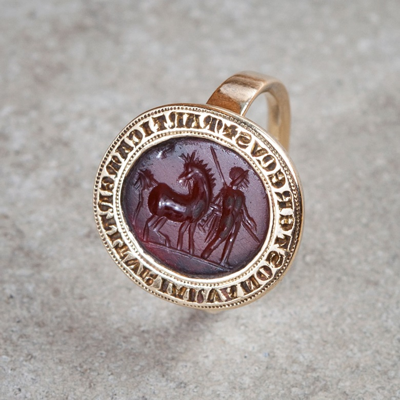 A carnelian signet ring with a Roman carving and 13th-century inscription, unearthed in 1760. Photograph by Peter Guenzel