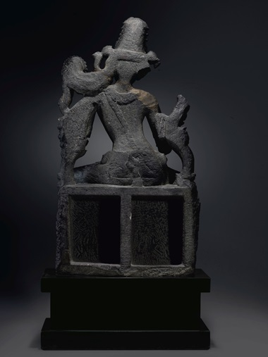 The back of the figure has been carved in deep relief, and the lotus throne that forms the work's base has been hollowed out — a feature which, Coyle suggests, could have been intended to lighten the work