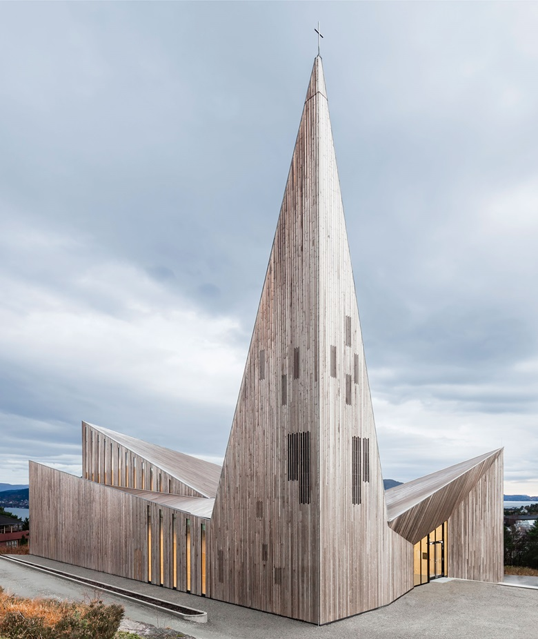 Community Church, Knarvik, Norway. Reiulf Ramstad Arkitekter, 2014 This dramatic building on the Norwegian coast is a modernist take on the wooden stave churches of Scandinavia. The 'windows' on the jag of a spire are in the  same wood as the rest — but heartwood, which is darker. These rectangular patches make the pale sapwood steeple seem less sharp and dangerous, less