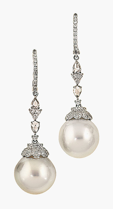 A pair of cultured pearl and diamond earrings. Sold for £1,750 on 21 January 2015 at Christie's South Kensington