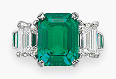 A three-stone emerald and diamond ring, by Carvin French. 4.42 carats, Colombia. No clarity enhancement. Sold for $293,000 on 10 December 2015 at Christie's in New York