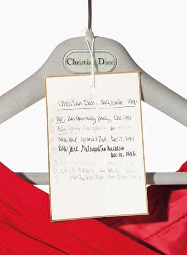A label documents where and when Mrs. Bloomingdale wore this Christian Dior couture red crepe gown