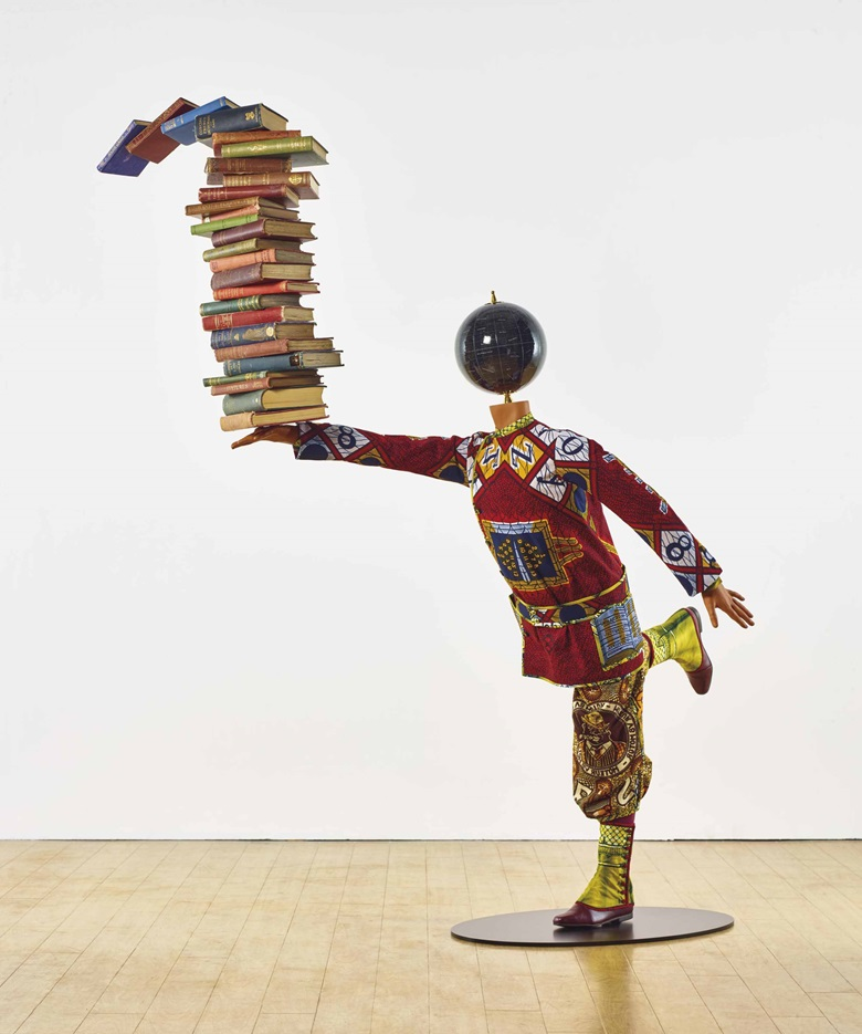 Yinka Shonibare, MBE (b. 1962), Boy Balancing Knowledge II, 2016. Fibreglass mannequin, Dutch wax printed cotton textile, books, globe, leather and steel baseplate, 71¼ x 29½ x 61⅞ in (181 x 75 x 157 cm). Estimate £50,000-70,000. This lot is offered in Post War & Contemporary Art Day Auction on 8 March 2017 at Christie's in London, King Street