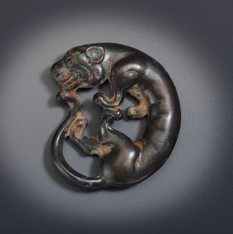 An unusual bronze feline-form weight. Eastern Zhou-Han Dynasty, 5th-3rd century BC. 2¼ in (5.7 cm) across. Estimate $2,000-3,000. This lot is offered in The Harris Collection Important Early Chinese Art on 16 March 2017 at Christie's in New York