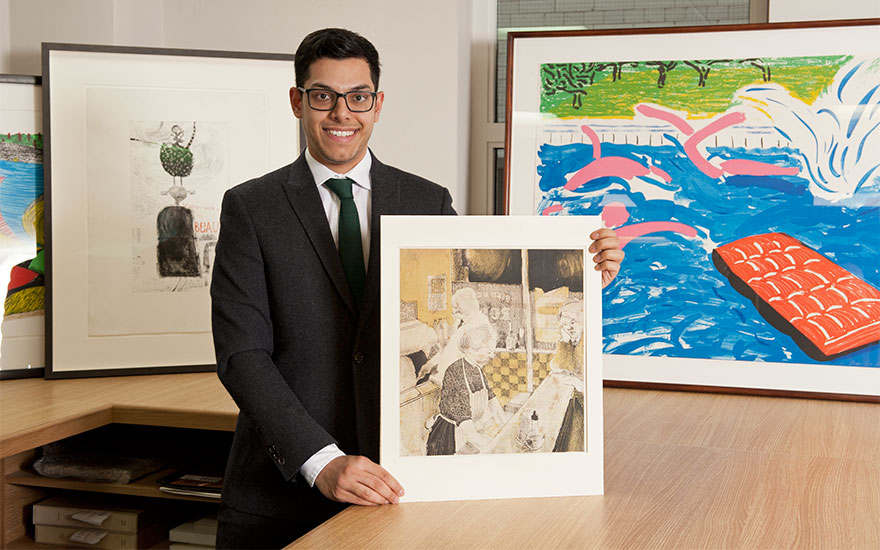 Christie's prints specialist James Baskerville with David Hockney's Fish and Chip Shop (1954)
