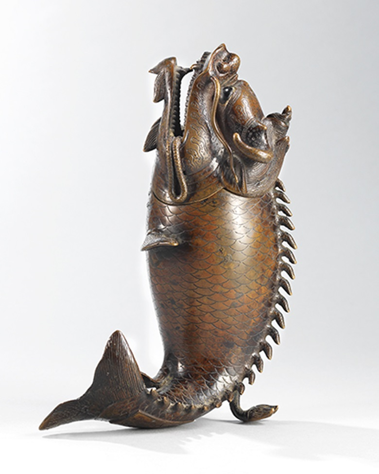 A bronze dragon fish-form censer, late Ming dynasty. 8 in (20 cm) high. Estimate HK$60,000-80,000 (US$7,800-10,000). This lot is offered in The Pavilion Sale on 4 April 2017 at Christie's in Hong Kong