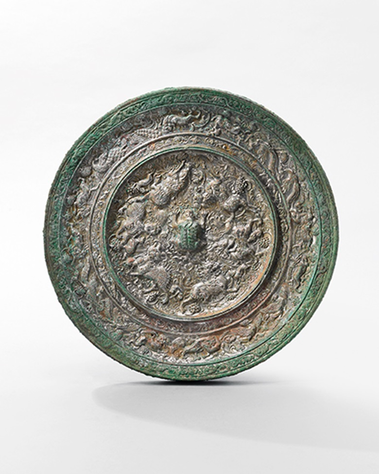 A very rare large 'Mythical Animals and Grapes' bronze mirror Tang dynasty (618-907). 10½ in (26.8 cm) diameter. Estimate HK$700,000-900,000 (US$91,000-120,000). This lot is offered in The Pavilion Sale on 4 April 2017 at Christie's in Hong Kong