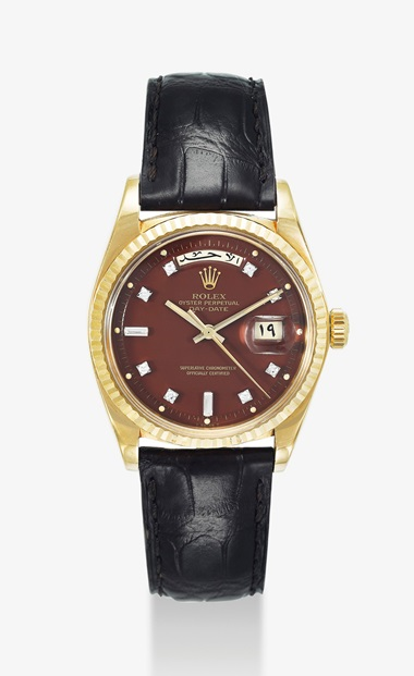 Rolex. A very rare 18K gold and diamond-set automatic wristwatch with sweep centre seconds, burgundy lacquer dial and Arabic calendar indication, made for the Sultanate of Oman. Signed Rolex, Oyster Perpetual day-date model, retailed by Asprey, ref. 1803, case no. 3'680'777, circa 1974. Estimate $30,000-50,000. This lot is offered in Important Watches on 19 March 2017 at Christies in Dubai