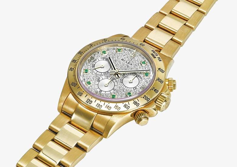 Rolex. A very rare and impressive 18K gold diamond and emerald-set automatic chronograph wristwatch with bracelet and box. Signed Rolex, Daytona model, ref. 16528, case no. T171471, circa 1996. Estimate $60,000-$80,0000. This lot is offered in Important Watches on 19 March 2017 at Christie's in Dubai