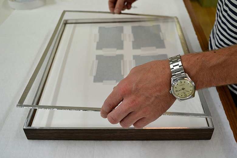 Framing with the use of special glazes and airtight seals can protect artworks from potential damage caused by temperature fluctuations, humidity and sunlight