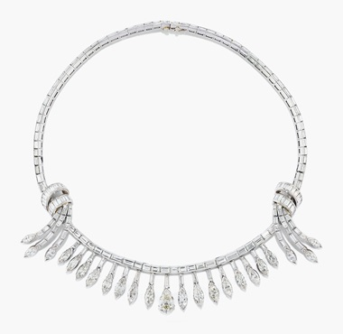 A diamond fringe necklace. The baguette-cut diamond line with tied ribbon detail, suspending a fringe of graduated marquise cut diamonds tassels with central pear-shaped diamond drop, 36.0 cm. Estimate SFr.22,000-32,000. This lot is offered in Magnificent Jewels on 17 May at Christie's in Geneva