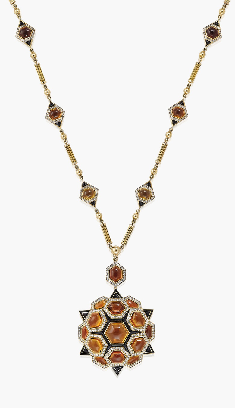 A quartz, onyx and diamond pendantbrooch necklace, by Bulgari. The pendant of stylised star design, set with cabochon smokey quartz, onyx panels and diamond accents, to the longchain necklace of reeded bar-link design, interspersed with smokey quartz, onyx and diamond panels, circa 1975. Pendant 8.0 cm, necklace 73.0 cm, mounted in gold, in pink leather Bulgari brooch. Estimate