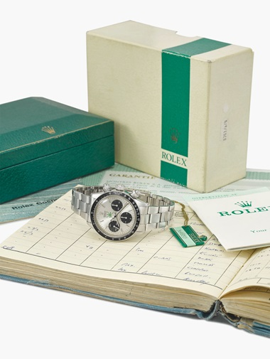 Rolex. An exceptionally rare stainless-steel chronograph wristwatch with green 'Khanjar' symbol, presented by the Sultan of Oman to the current owner in 1974, sold with the original sales tag, box, period blank guarantee and brochures. Rolex, Oyster Cosmograph, Daytona model, ref. 6263, case no. 3'048'293, circa 1972. Estimate SFr.320,000-420,000. This lot is offered in