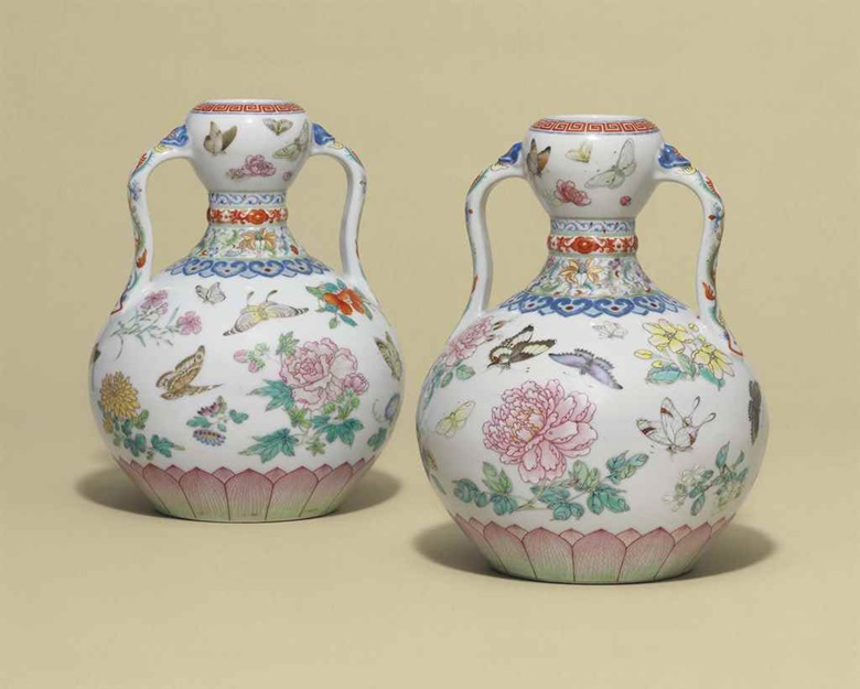 A magnificent pair of famille rose butterfly double-gourd vases, Qianlong six-character seal marks in underglaze blue and of the period (1736-1795). 9 in (23 cm) high. Sold for £14,725,000 in Fine Chinese Ceramics and Works of Art on 9 May at Christie's London