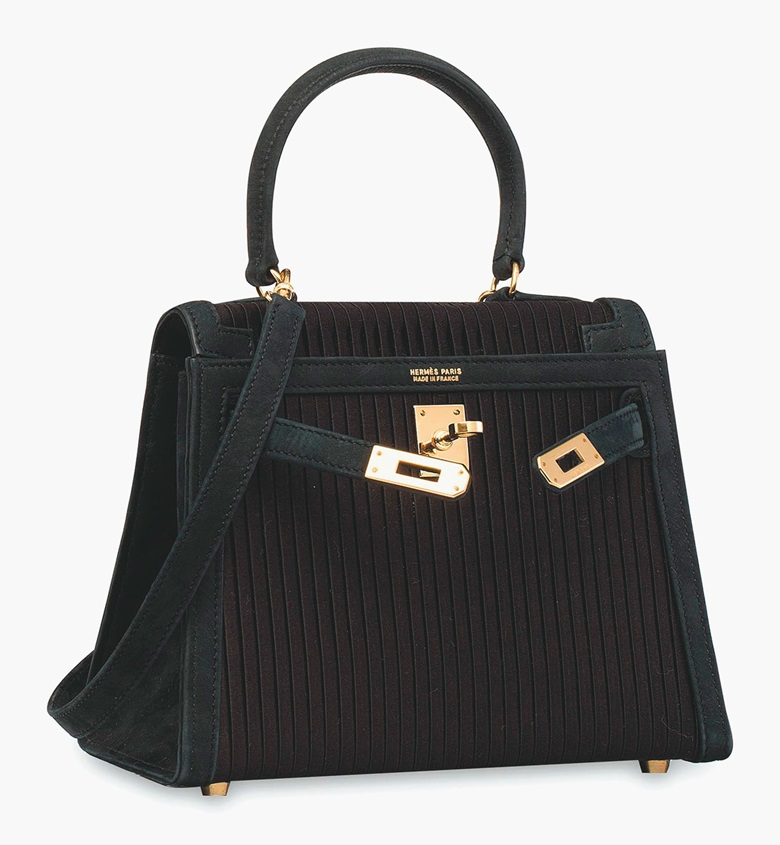A Bleu Marine ribbed satin Mini Sellier Kelly 20 with gold hardware, Hermès 1991. Estimate HK$80,000-100,000  $11,000-13,000. This lot is offered in Handbags & Accessories  on 31 May 2017 at Christie's in Hong Kong
