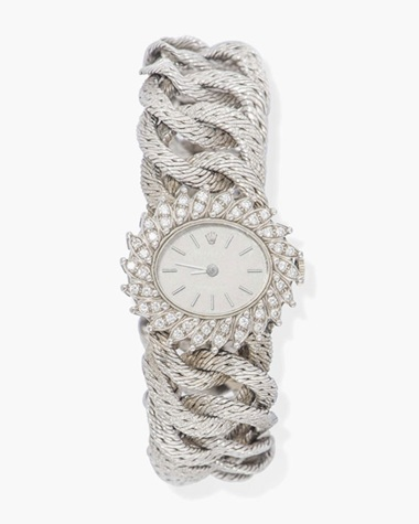 A ladys diamond bracelet watch, by Rolex. This lot was offered in Jewellery & Watches on 9 May 2017 at Christie's in London and sold for £2,750