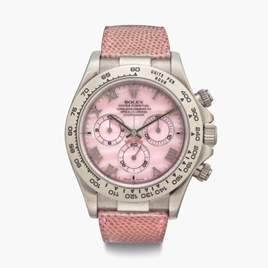 A modern pink Rolex Daytona Beach with a mother-of-pearl dial and lizard strap matching the dial colour