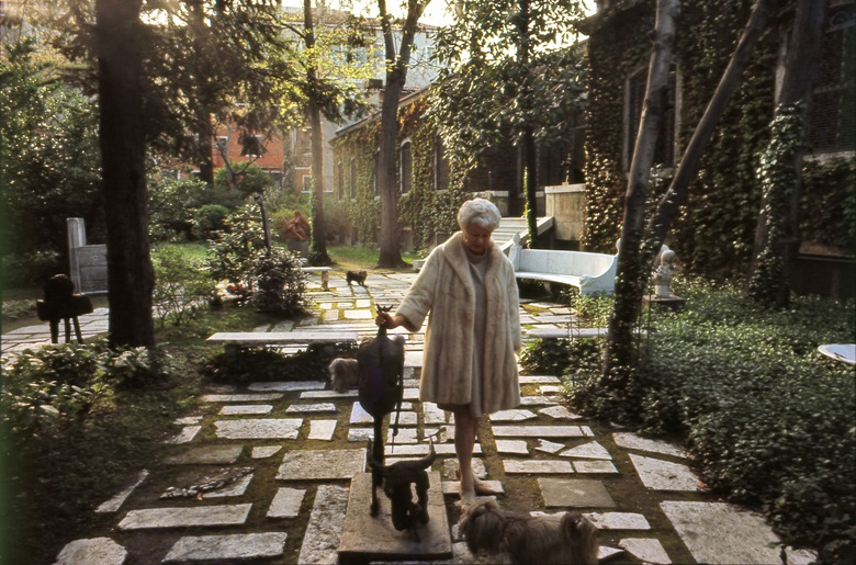 Peggy Guggenheim and her dogs in the palazzo gardens, with Germaine Richier's sculpture, Tauromachy, 1953. Photo Ray Wilson. Courtesy of Peggy Guggenheim Collection Archives. Artwork © ADAGP, Paris, and DACS London 2017