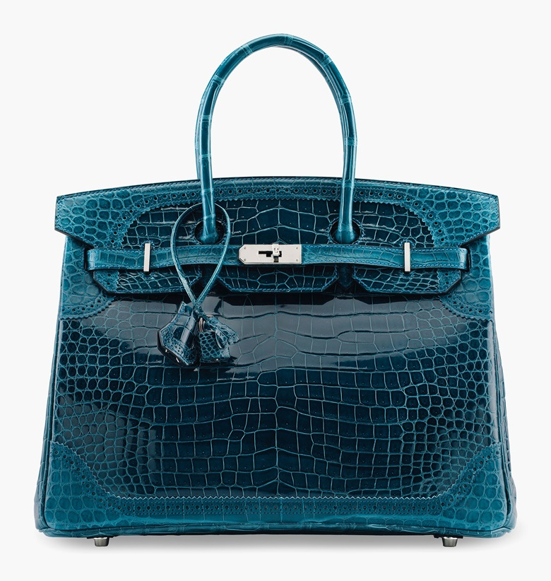 A limited-edition shiny & matte bleu colvert porosus crocodile Ghillies Birkin 35 with palladium hardware, Hermès, 2015. Estimate $50,000-60,000. This lot is offered in the Handbags & Accessories Online sale, 13-22 June
