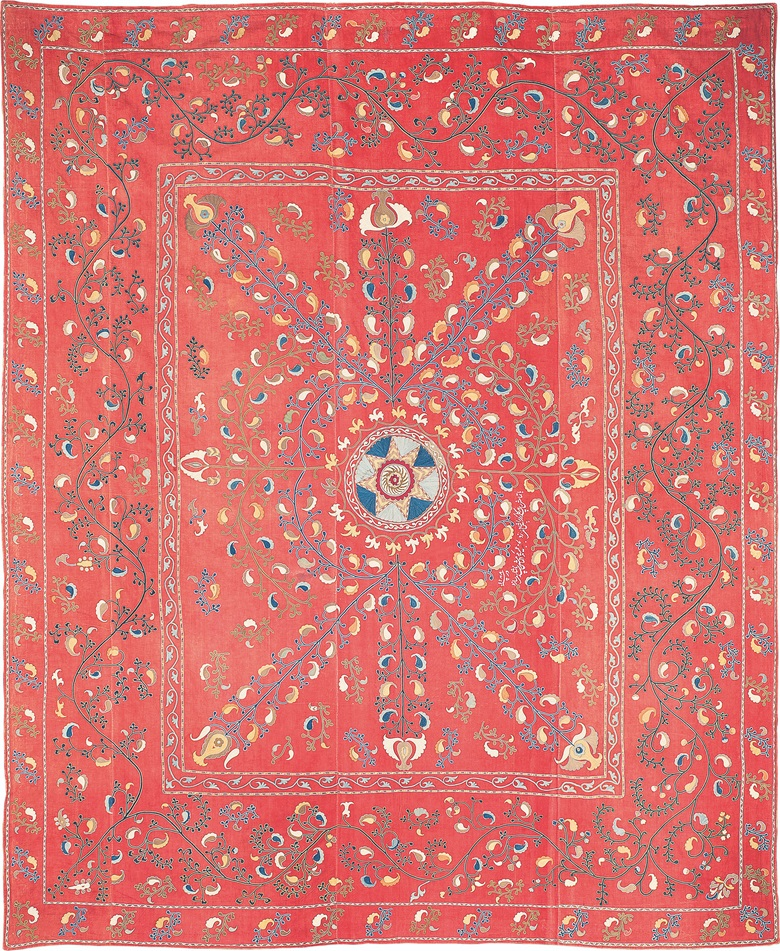 A suzani, Ura Tube region, Tajikistan, 1871. Near square form, embroidered decoration of foliate stems bearing floral buds radiating from central star motif framed with scrolling tendrils, borders with stylised foliate patterns, white embroidered Persian inscription in nastaliq script. 109 x 89½ in (277 x 227.5 cm). Sold for £5,250 at Arts & Textiles of the Islamic & Indian