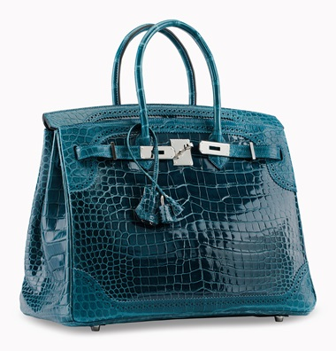 A limited edition shiny & matte bleu colvert porosus crocodile Ghillies Birkin 35 with palladium hardware. HermÈs, 2015. 14 x 10 x 7 in. Estimate $50,000-60,000. This lot is offered in Handbags & Accessories, 13-22 June 2017, Online The especially rare Ghillies trim, inspired by a Scottish men's dress shoe, sets this exotic Birkin apart from the rest.
