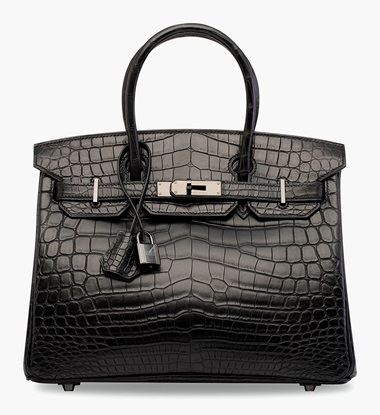 A rare, matte black niloticus crocodile So Black Birkin 30 with black hardware. Hermès, 2010. 30 x 22 x 15 cm. Estimate HK$300,000-400,000. This lot is offered in Handbags & Accessories  on 31 May 2017 at Christie's in Hong Kong  An already sought-after crocodile Birkin becomes even more exclusive with its limited-production So Black hardware.