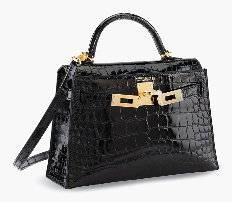 A shiny black alligator sellier Mini Kelly 20 II with gold hardware, Hermès, 2017. Estimate $25,000-35,000. This lot is offered in the Handbags & Accessories Online sale, 13-22 June