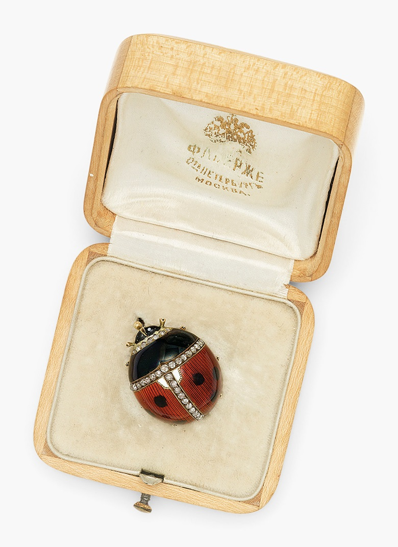 A jewelled guilloché and en plein enamel gold brooch in the form of a ladybird by Fabergé, with the workmasters mark of Michael Perchin, St. Petersburg, 1899-1903, scratched inventory number partially visible, possibly 65746. This work was offered in Russian Art on 5 June 2017 at Christie's in London and sold for £32,500