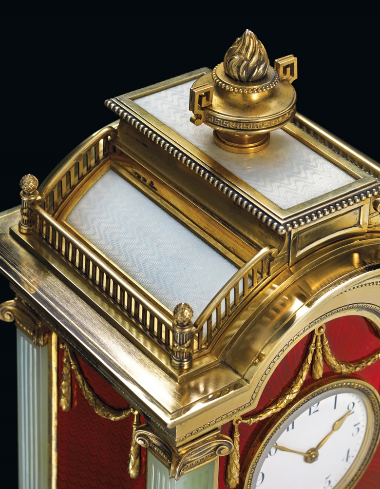A highly important and impressive silver-gilt and guilloché enamel bowenite mantel clock marked Fabergé with the imperial warrant, with the workmaster's mark of Julius Rappoport, St. Petersburg, 1899-1904, scratched inventory number 7532. This work was offered in Russian Art on 5 June 2017 at Christie's in London