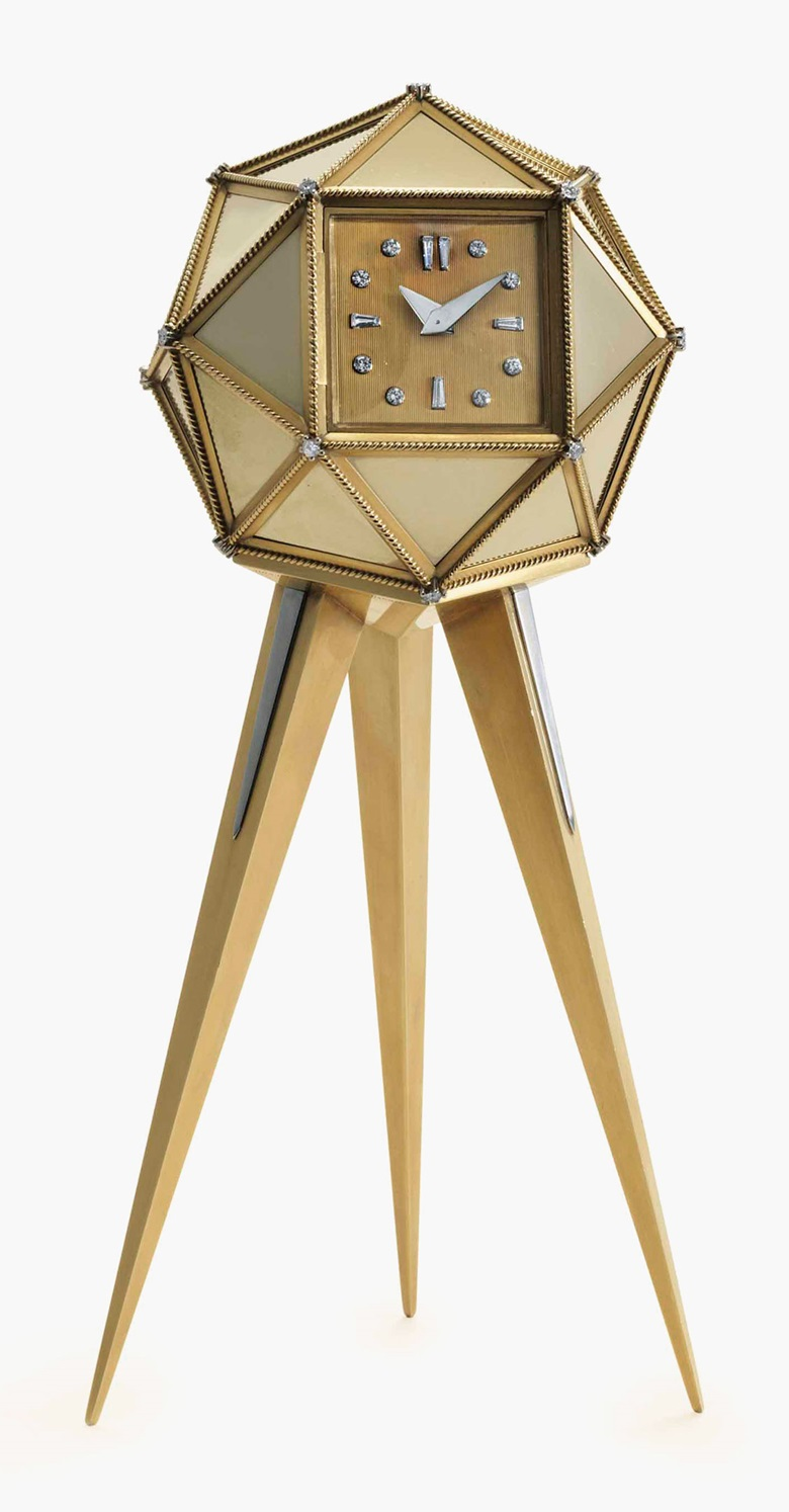 Cartier. A very fine 18k gold, silver and diamond-set polyhedral desk clock, signed Cartier London, Designed by R. Emmerson, Case Nos. 8837 6012, Movement No. 740, Manufactured in 1958. Estimate $80,000-120,000. This lot is offered in Rare Watches and American Icons on 21 June at Christies in New York