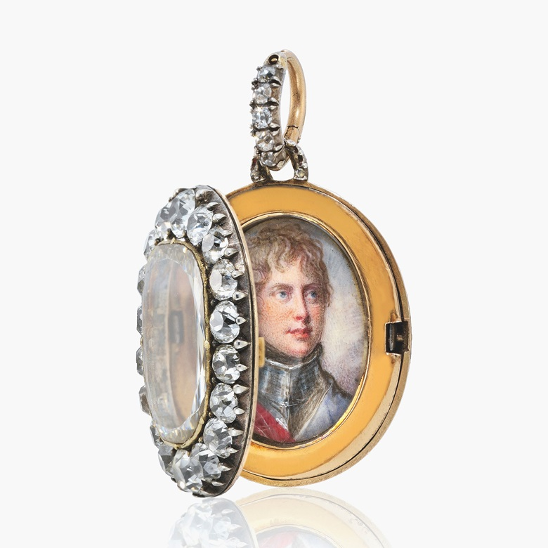 The Maria Fitzherbert jewel. A diamond-glazed gold locket containing a portrait miniature of King George IV when Prince of Wales (1762-1830). The portrait miniature, on ivory, by Richard Cosway, R.A. (British, 1742-1821), the locket almost certainly supplied by Rundell, Bridge & Rundell, London, circa 1800. Oval, 37 mm high, including the suspension loop, the lockets cover centred with a