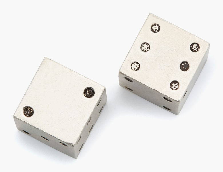 Cartier pair of silver and enamel dice. Estimate $400-600. This lot is offered in Christie's Jewels Online on 14-22 June 2017